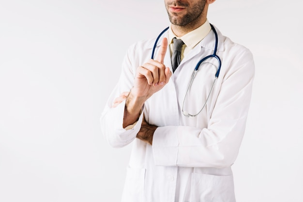 Close-up of a male doctor pointing index finger Free Photo