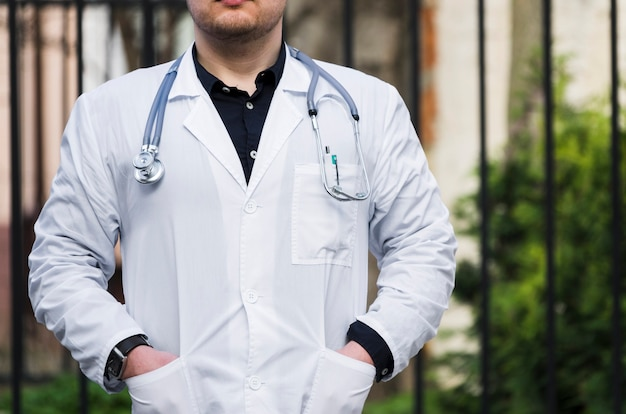 Close-up of a male doctor with stethoscope around his neck at outdoors Free Photo