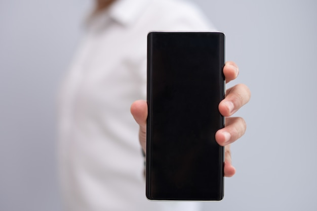 Close-up of male hand showing new model of smartphone Free Photo