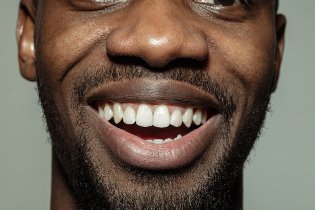 Close-up male mouth with big smile and healthy teeth ...