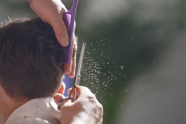 Close-up man cutting a boy's hair at home you need to update the child's hair Premium Photo