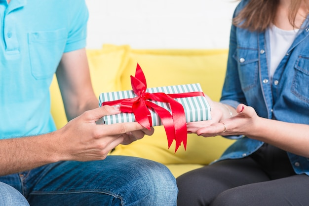 Close-up of a man giving valentine gift to his girlfriend Free Photo