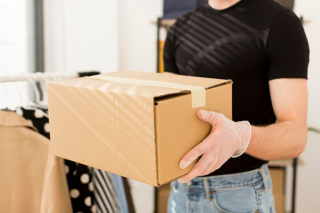 Close-up man holding box Free Photo