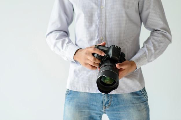 Close-up man holding camera Free Photo