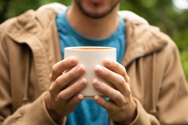 Close-up of man holding coffee cup Free Photo