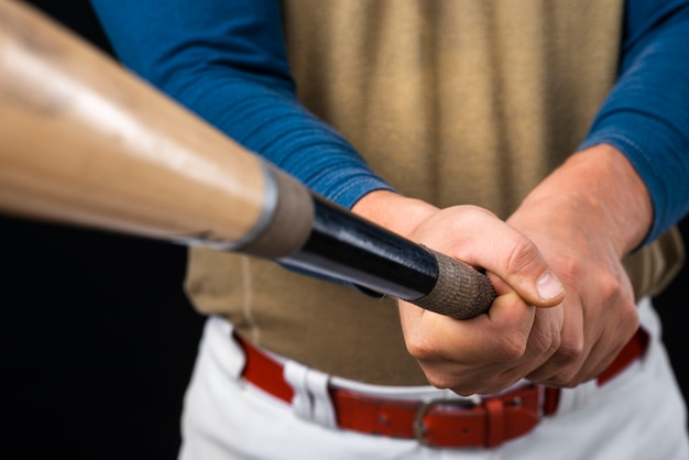 Close-up of man holding defocused baseball bat Free Photo