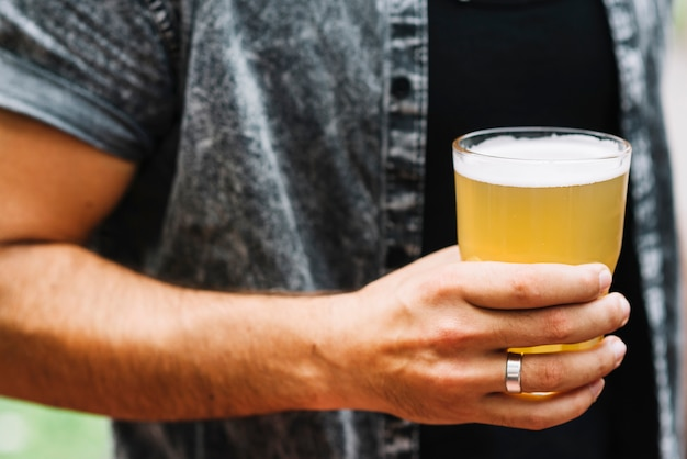 Close-up of man holding glass of beer Free Photo