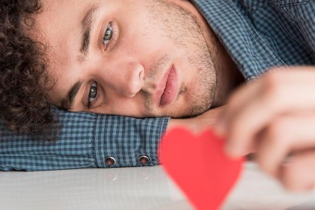 Close-up man holding heart Free Photo