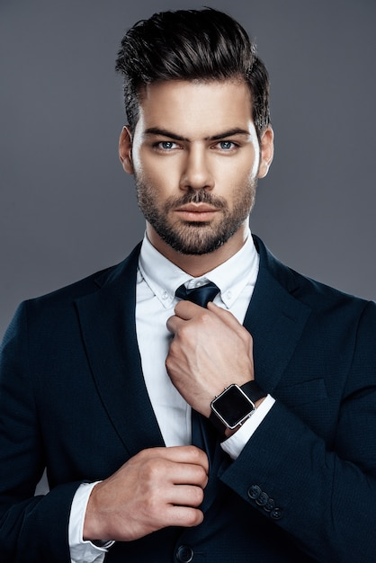 Close-up man is in a white shirt with a tie Premium Photo