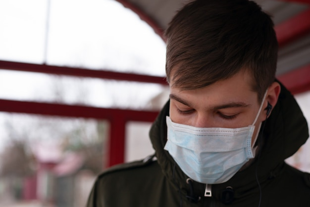 Close-up of a man in a medical mask, quarantine in russia, ukraine. viral infection covid-19.coronavirus pandemic epidemic. Premium Photo