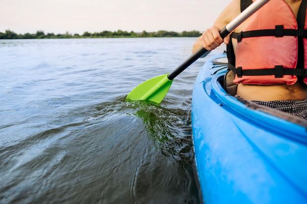 Close-up of man paddling kayak Free Photo