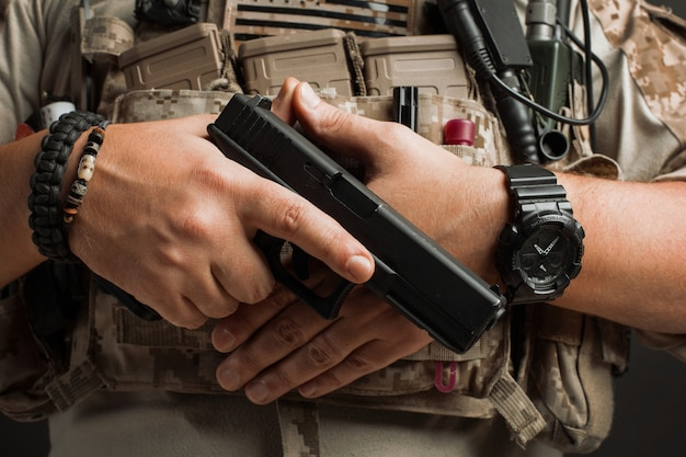 Close-up of a man pulls a gun from his holster. Premium Photo