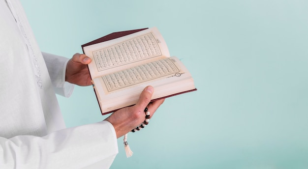 Close up of man reading in quran Free Photo