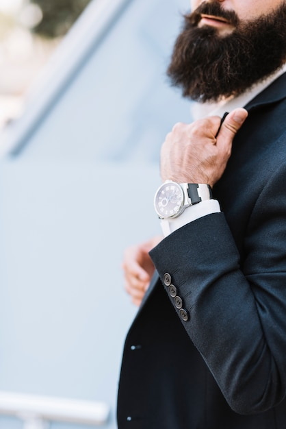 Close-up of man's hand with a wrist watch Free Photo