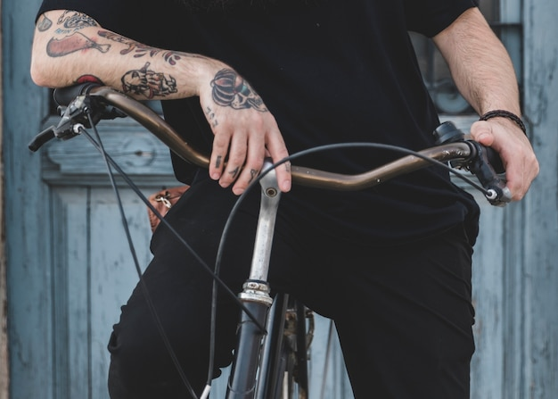 Close-up of a man sitting on bicycle Free Photo