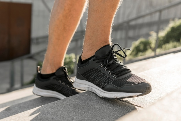 Close-up on man sport shoes Free Photo