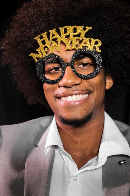 Close-up man wearing a happy new year 2020 party glasses Free Photo