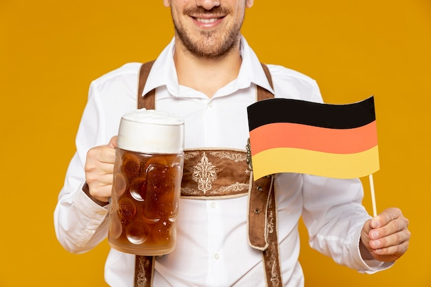 Close-up of man with beer pint and flag Free Photo