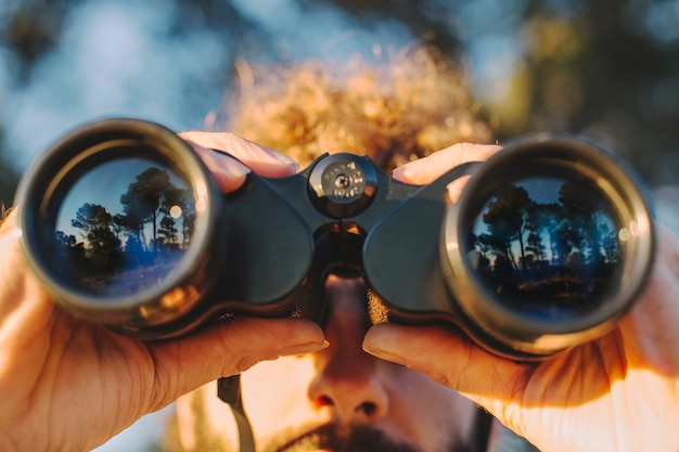 Close-up man with binoculars Free Photo