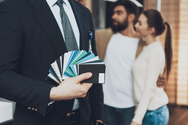 Close up manager in suit is holding color swatches Premium Photo