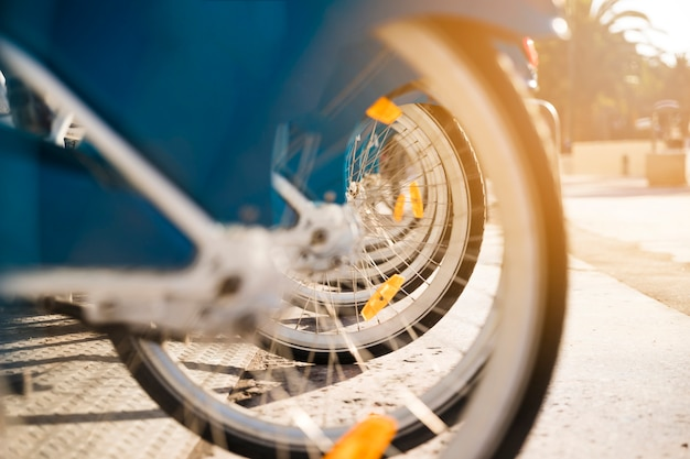 Close-up of many bicycle wheels stand in a row Free Photo
