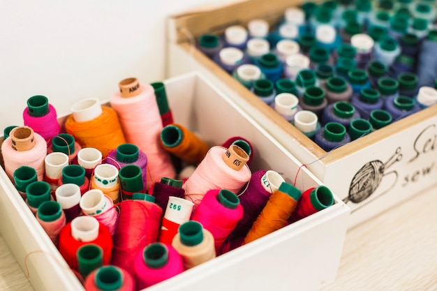 Close-up of many colorful threads in container Free Photo