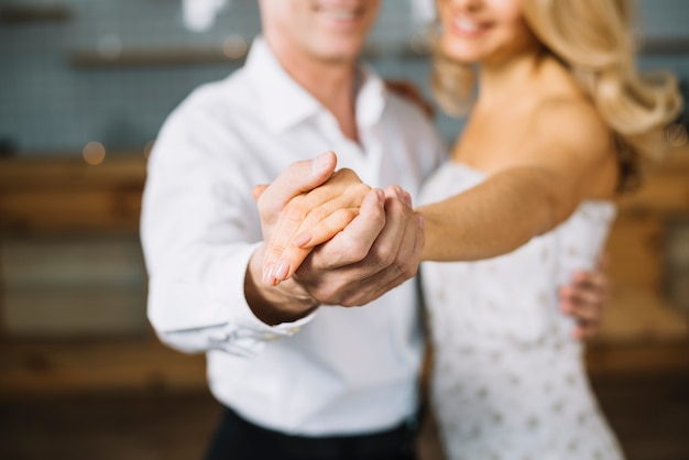 Close-up of married couple dancing Free Photo