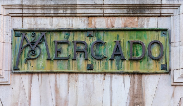Close-up of mercado de abastos, in spanish. in oxidized bronze, with green and ocher tones. Premium Photo
