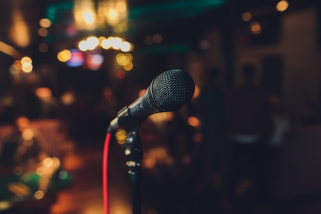 Close up of microphone in concert hall or conference room. Premium Photo