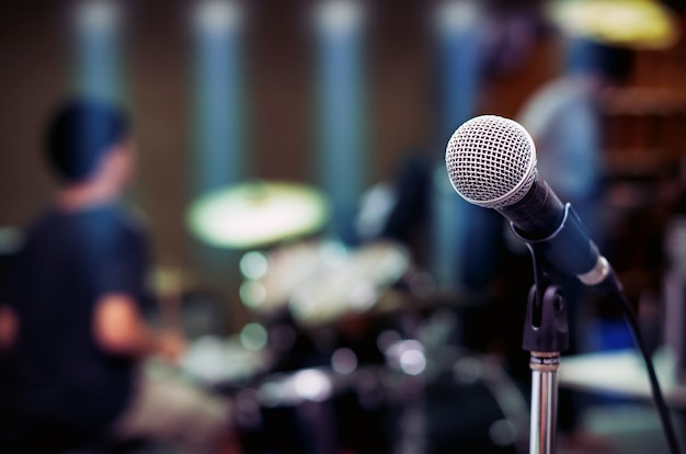 Close up of microphone on musician blurred background Premium Photo