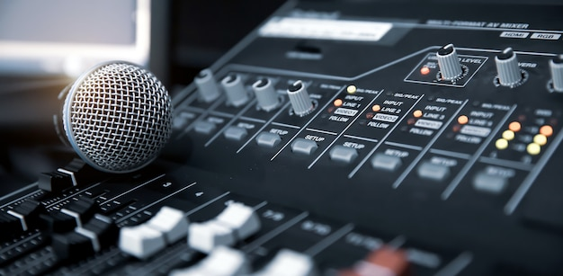 Close-up microphone on sound mixer equipment for recording Premium Photo