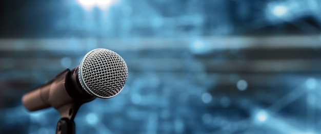 Close-up the microphone on stand for speaker speech for background. Premium Photo