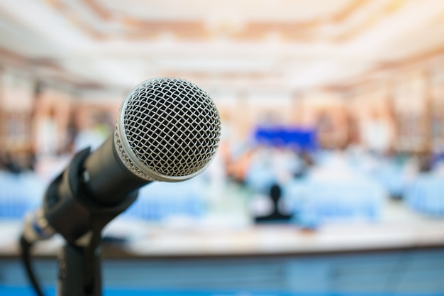 Close-up microphones on abstract blurred of speech in meeting room Premium Photo