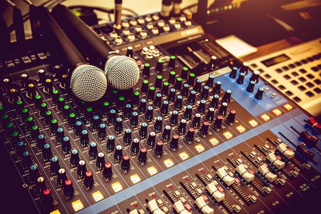 Close up microphones and audio mixer in studio Premium Photo