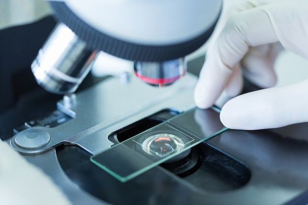 Close up of microscope at the blood laboratory, concept science and technology Premium Photo