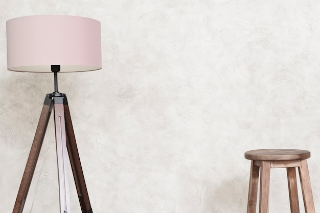 Close-up minimalist designer floor lamp and bar stool Free Photo