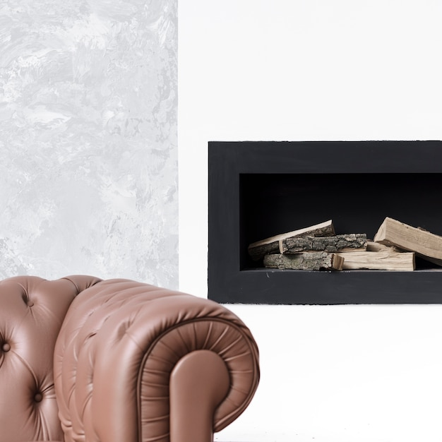 Close-up minimalist fireplace  and sofa Free Photo