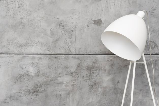 Close-up minimalist white floor lamp with concrete panels Free Photo