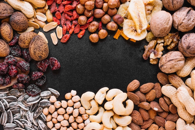 Close-up of mixed fruit and nuts Free Photo