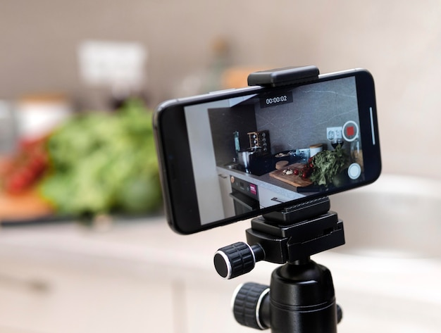 Close-up mobile phone on tripod recording Premium Photo