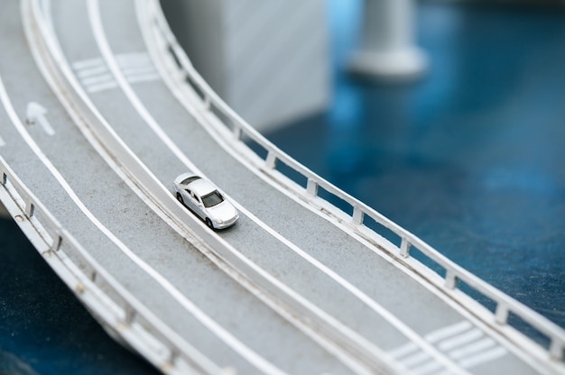 Close up of model small cars on the overpass, traffic concepts. Free Photo