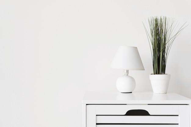 Close-up modern minimalist night stand with decoration Free Photo