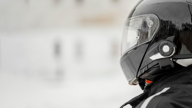 Close up motorcyclist with helmet Free Photo
