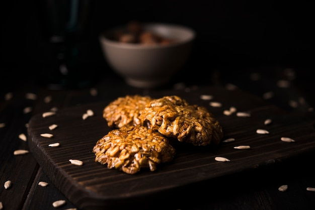 Close-up muesli cookies on wooden board Free Photo