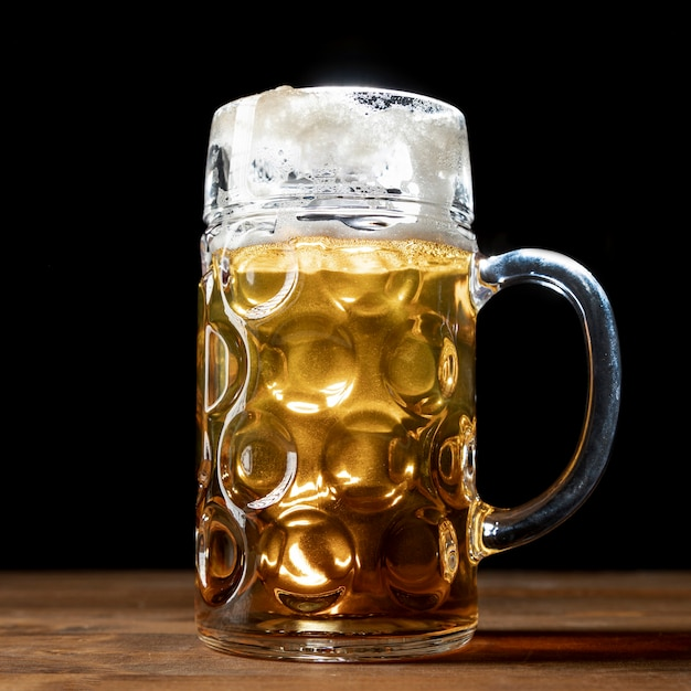 Close-up mug of beer on a table Free Photo