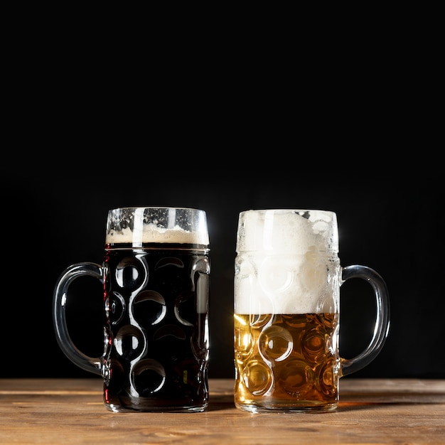 Close-up mugs of bavarian beer on a table Free Photo