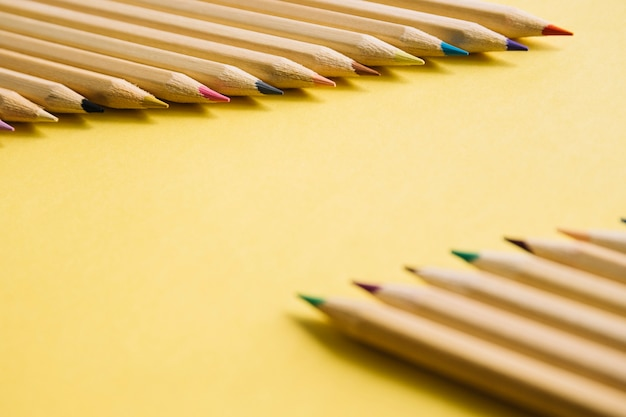 Close-up of multi colored pencils on yellow background Free Photo