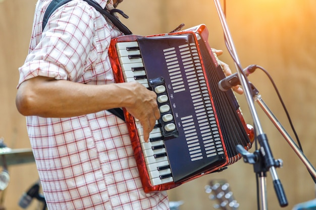 Close up musicians are playing accordion on stage Premium Photo