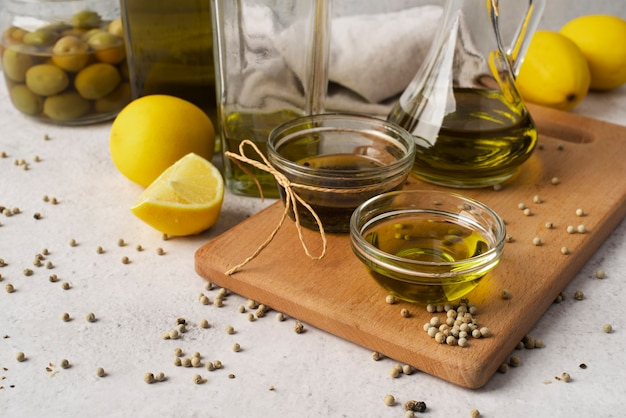 Close-up natural olive oil and olives Free Photo
