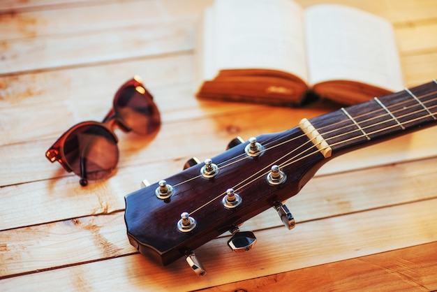 Close up neck acoustic classical guitar on a light wooden background Premium Photo